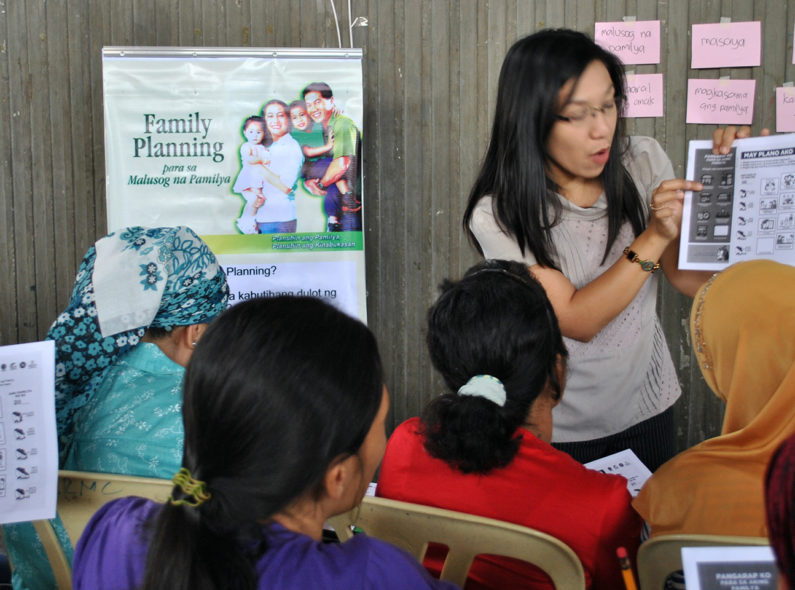 An instructor discusses family planning