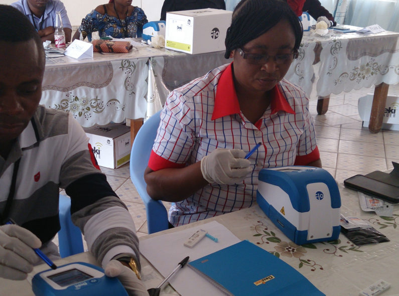 health workers using mobile malaria testing technology