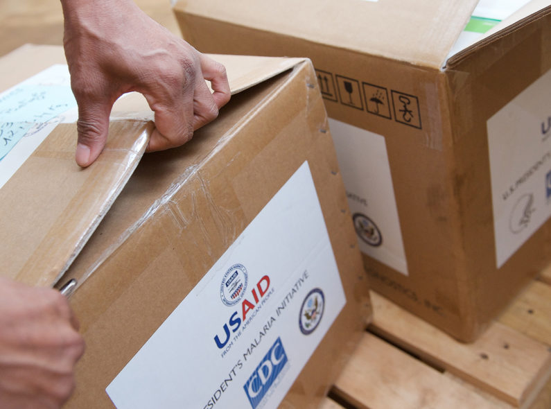 Boxes of health commodities being opened in Mozambique