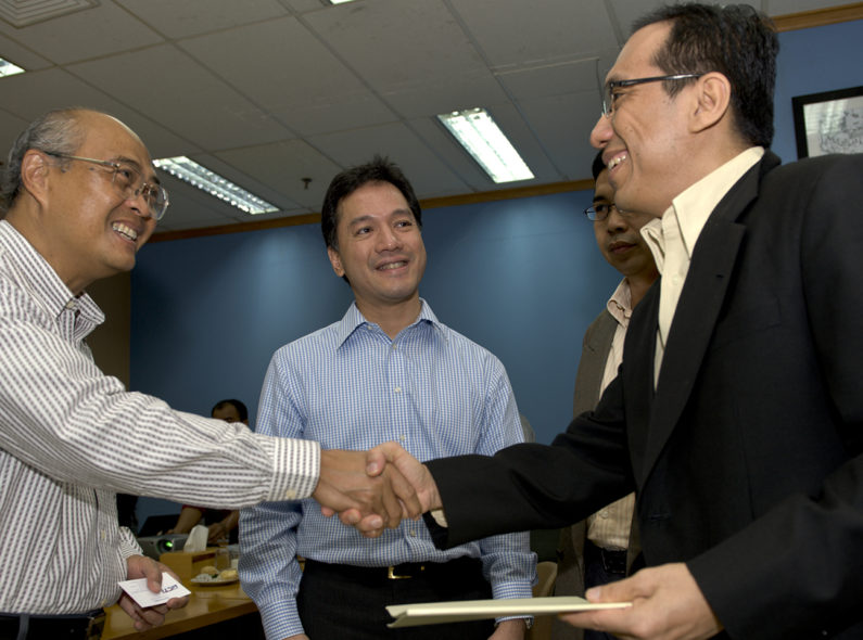 Men shaking hands and smiling