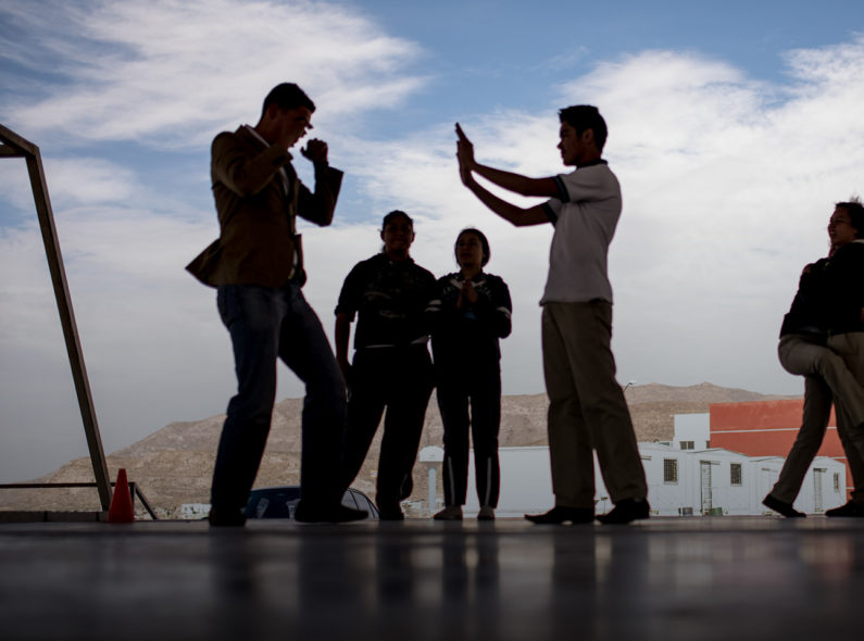 A group of teenagers practice self-defense