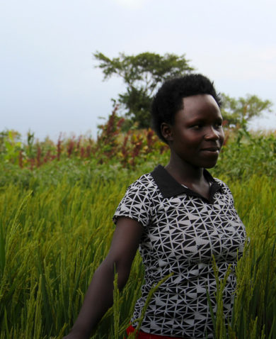 A young woman stands in a field