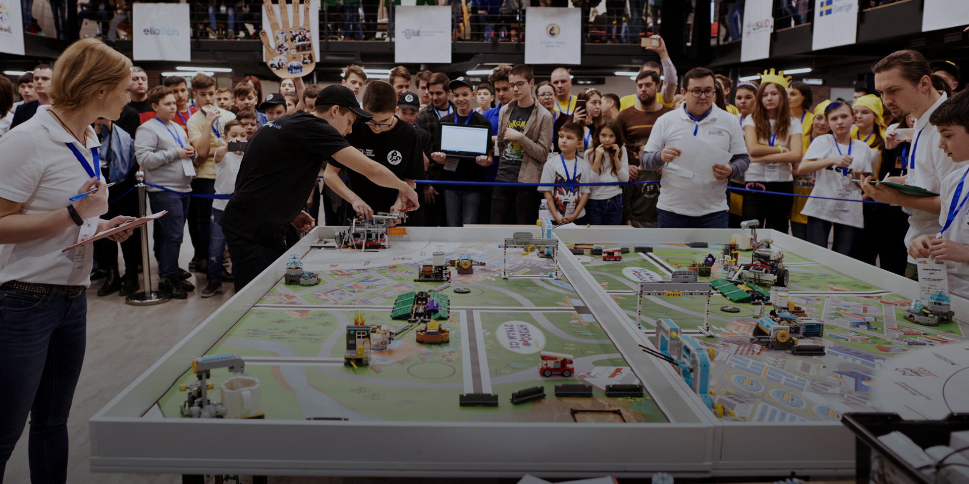 Youth compete in a robotics competition.