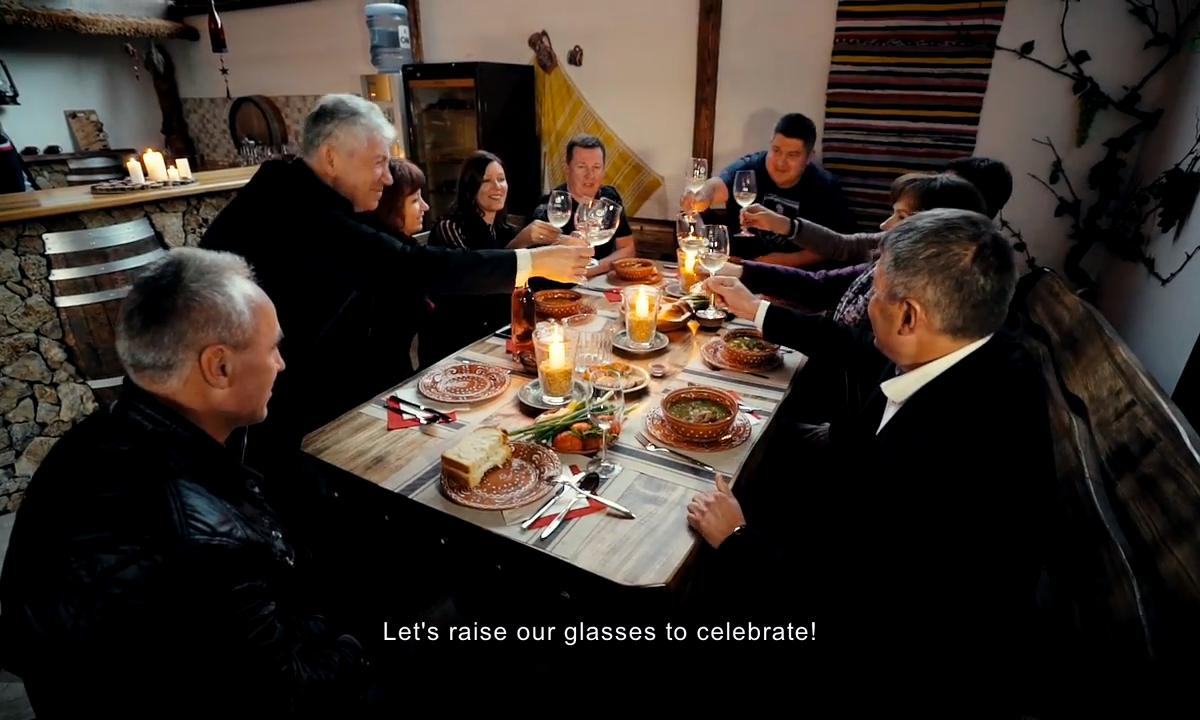 winemaking family toasting around a table