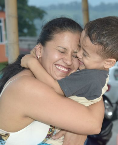 Colombian mother hugging child