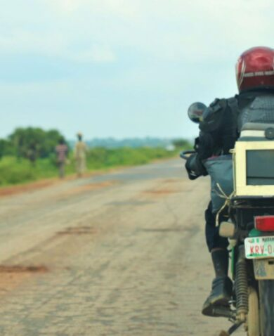A third party logistics provider uses a motorbike to transport samples across Nigeria.