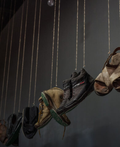 "Photograph taken at the exhibition ""Huellas de la Memoria,"" where 220 pairs of hanging shoes and footprints engraved with the names of missing people speaks of disappearances in a country with more than 73,000 cases."