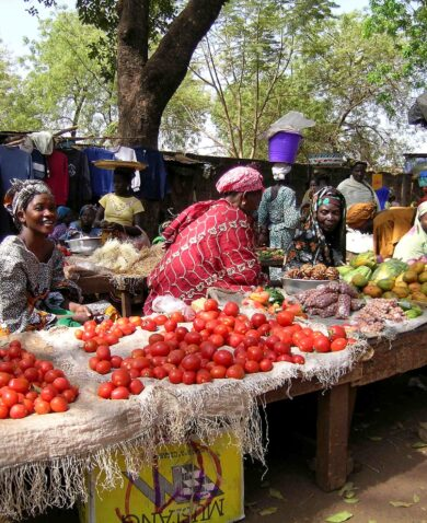 Women sell fruit and vegetables at a market in Sikasso, Mali.